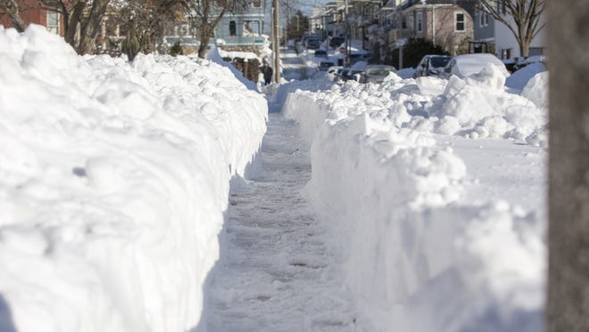 """Shoveled walk in Boston, Jan. 5, 2018, the day after a """"bomb cyclone"""" snow storm."""
