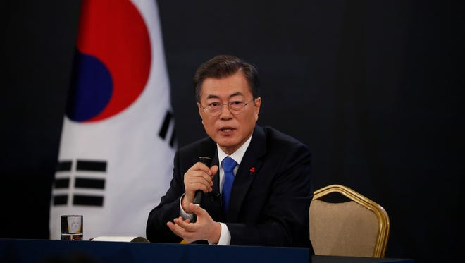 South Korean President Moon Jae In answers reporters' question during his New Year news conference at the Presidential Blue House in Seoul, South Korea, on Jan. 10.