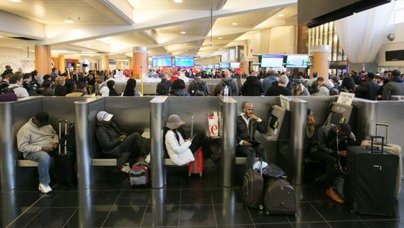Stranded passengers relax near baggage claim at Hartsfield-Jackson