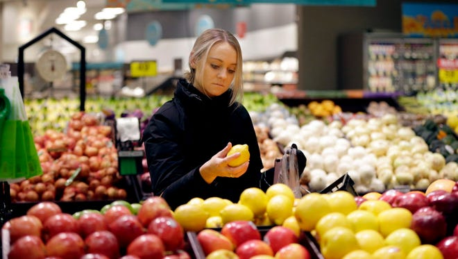 Haley Slack of Milwaukee looks over the produce at Metro Market, 1123 N. Van Buren St., on Jan. 31, 2018, when Roundy's unveiled a remodeling of the store.