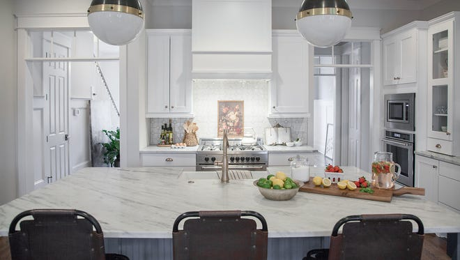 """The """"super island"""" Carbine & Associates is including in many of their new homes in Williamson County and Nashville has room for the family chef, homework and makes a generous buffet area for dinner parties."""