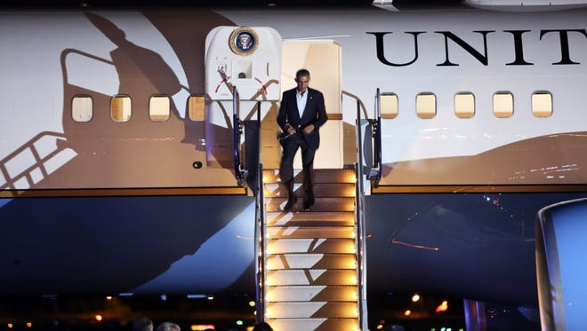 President Obama exits Air Force One after arriving in  Philadelphia on Sunday.