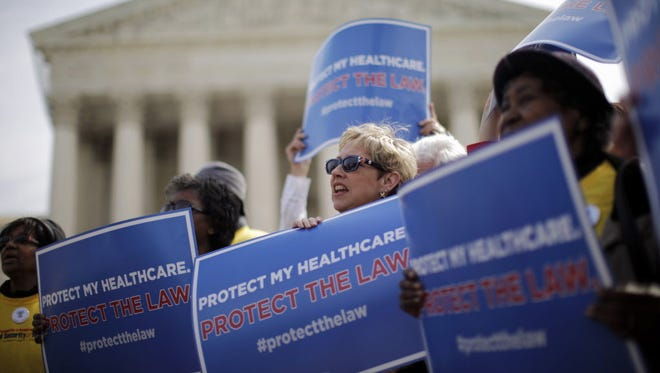 Supporters of health care reform rally at the Supreme Court in 2012.