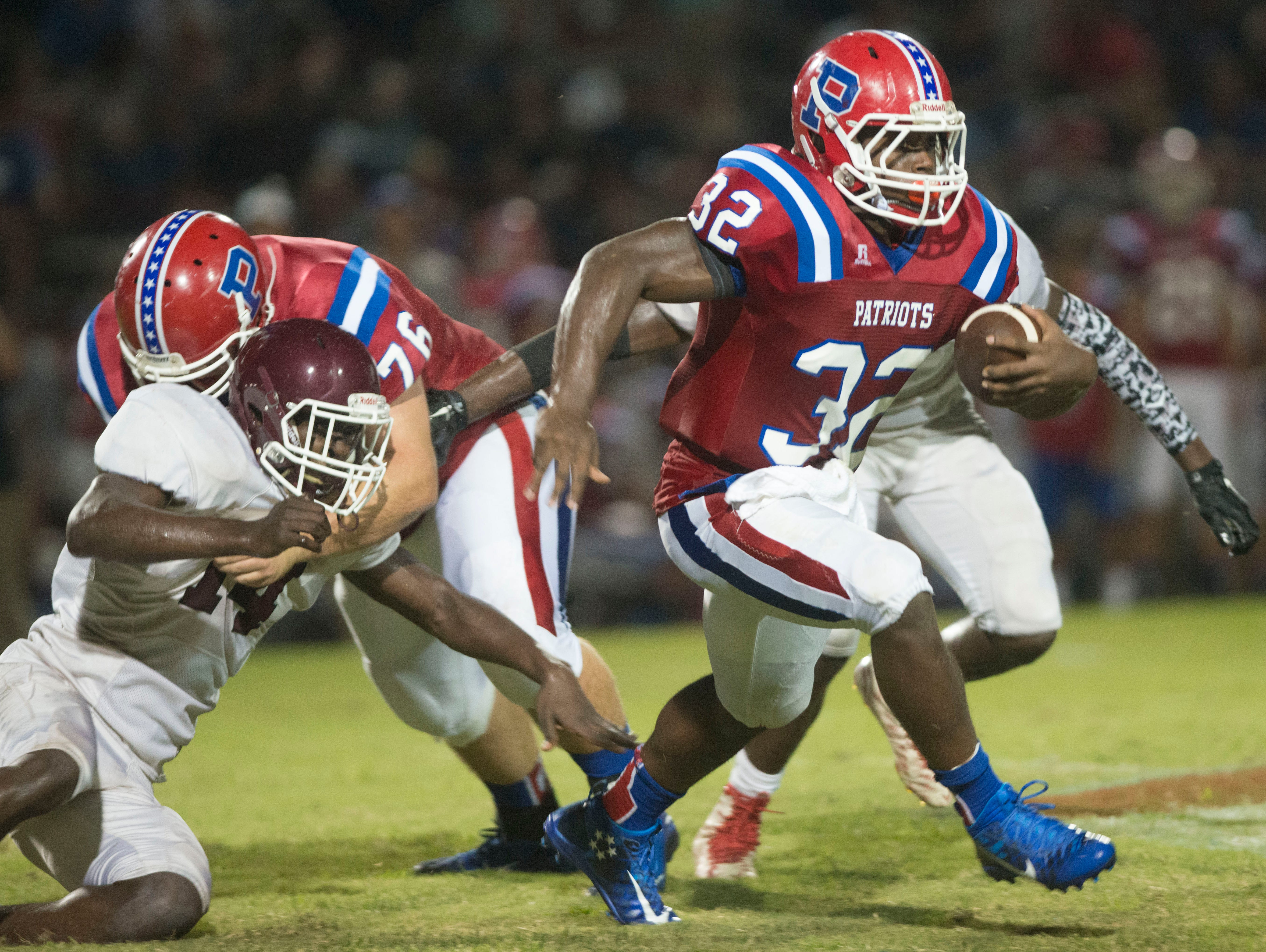 Pace High's Anthony Johnson, Jr., (No.32) slips past the Pensacola High defense during Friday night's home game against the Tigers.