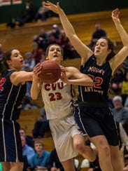 Shannon Loiseau, center, is one of the key frontcourt pieces back for the five-time defending state champion Champlain Valley.