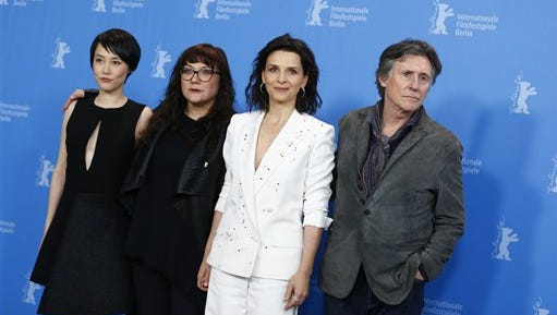 From left, Japanese actress Rinko Kikuchi, Spanish director Isabel Coixet, French actress Juliette Binoche, and Irish actor Gabriel Byrne, during the Nobody Wants the Night  photo call at the 2015 Berlinale Film Festival in Berlin, Thursday.