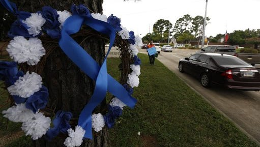 A car passes by a wreath that rests across the street from a gas station where Deputy Darren Goforth was fatally shot Tuesday, Sept. 1, 2015, in Houston. Godforth was shot while at a gas station. The man accused of fatally shooting the suburban Houston officer was committed to mental health facilities in the last five years and his attorney said Tuesday the man will undergo a psychological evaluation. (Steve Gonzales/Houston Chronicle via AP) MANDATORY CREDIT