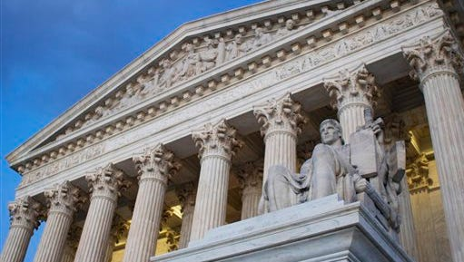 FILE - In this Feb. 13, 2016 file photo, the Supreme Court building in Washington. Is eight enough? The Supreme Court has managed to function effectively at less than its full nine-member strength for two extended periods in the past 50 years. The question now is whether the death of Justice Antonin Scalia in the middle of the court term and a polarizing presidential campaign will make it harder for the justices to get their work done.  (AP Photo/Jon Elswick, File)
