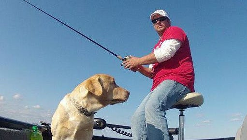 Corey Clark with his dog Duke waiting for a walleye to bite.
