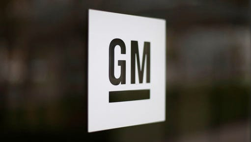 FILE - This Friday, May 16, 2014, file photo, shows the General Motors logo at the company's world headquarters in Detroit. General Motors says it has halted operations in Venezuela after authorities seized a factory. The plant was confiscated on Wednesday, April 19, 2017, in what GM called an illegal judicial seizure of its assets. GM says its due process rights were violated and it will take legal steps to fight the seizure.