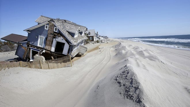 Homes severely damaged in October 2012 by Superstorm Sandy are seen along the beach in Mantoloking in this file photo.  (AP photo)