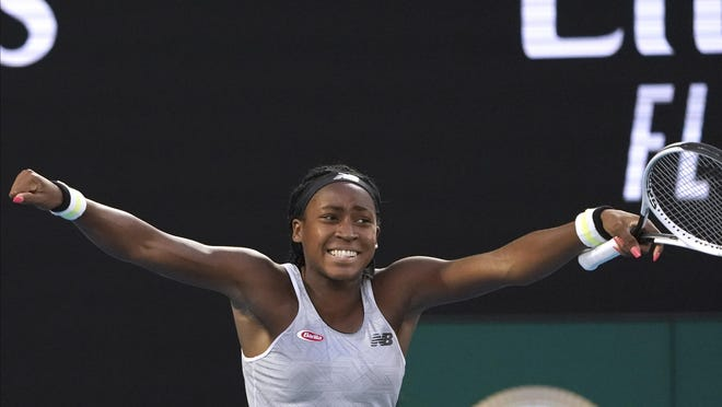 Coco Gauff of the U.S. celebrates after defeating Japan's Naomi Osaka in their third round singles match at the Australian Open tennis championship in Melbourne, Australia, Friday, Jan. 24, 2020.