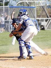 Horseheads catcher Andrew Thompson tags out Corning's