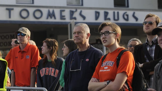 Auburn fans watch as the Toomer's oaks are cut down  April 23, 2013.