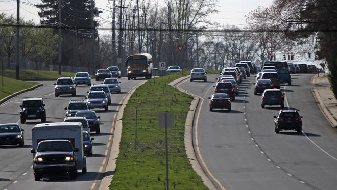 Rush-hour traffic flows earlier this year along Lancaster Pike at Centerville Road, near the former Delaware National Country Club. New Castle County Council is weighing tweaks to the rules that dictate new construction.