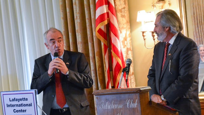 Monsieur Alain Baraton, Gardener-in-chief of the Park at the Palace-Chateau of Versailles, France, speaks through his interpreter at the Petroleum Club in  Lafayette on Tuesday.