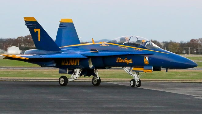 Marine Capt. Corrie Mays and Navy Lt. Tyler Davies taxi the Blue Angels   No. 7 to the terminal of Smyrna Airport Thursday afternoon as part of a site visit in advance of the 2016 Great Tennessee Air Show June 4-5.