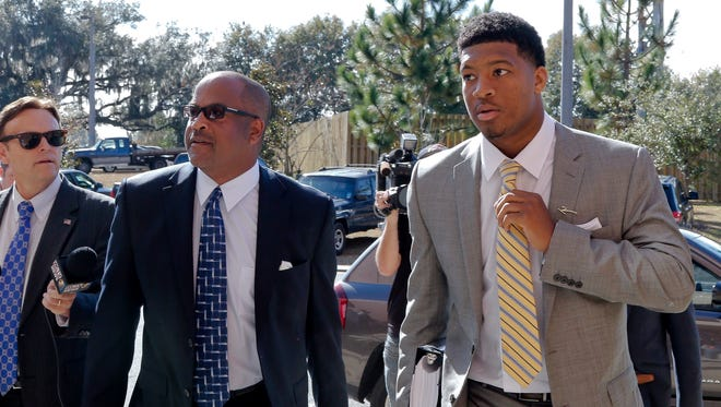 In this Dec. 2, 2014, file photo, Florida State quarterback Jameis Winston, right, and his attorney David Cornwell arrive at Florida State's Materials Research building for his student Conduct code hearing,  in Tallahassee, Fla. Florida State University said Monday it's settling a lawsuit with a former student who said the school failed to respond when she accused former star quarterback Jameis Winston of rape.