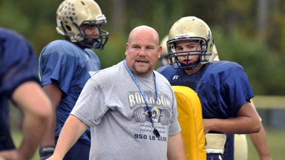 Former Roberson football coach Jim Beatty has been hired as North Henderson's new head football coach.