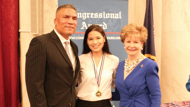 Guam resident Athena McNinch recently was named a winner of the Congressional Award Gold Medal. From left: Congressional Award Chairman Paxton Baker, Athena McNinch and Guam Del. Madeleine Bordallo.