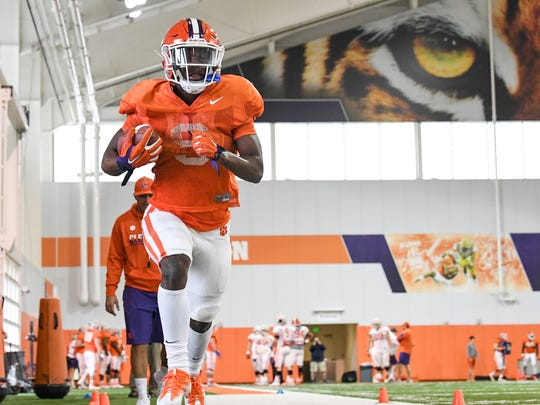 Clemson running back Travis Etienne (9) during football practice in Clemson on Wednesday.