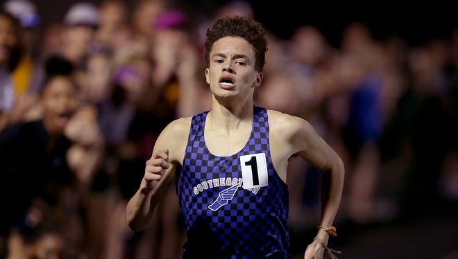 Hamilton Southeastern's Gabe Fendel (1) cruised to an easy win in the Boys Miracle Mile  at the Flashes Showcase Invitational Friday, April 14, 2017, evening at Franklin Central High School.