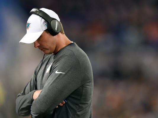 Miami Dolphins head coach Adam Gase walks on the sideline in the second half of an NFL football game against the Baltimore Ravens, Thursday, Oct. 26, 2017, in Baltimore. (AP Photo/Gail Burton)