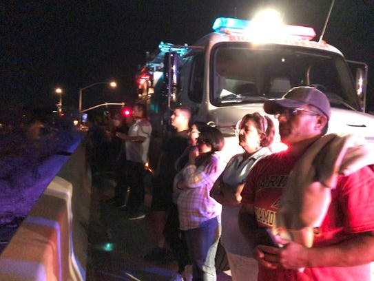 Dozens of Nogales-area residents packed overpasses