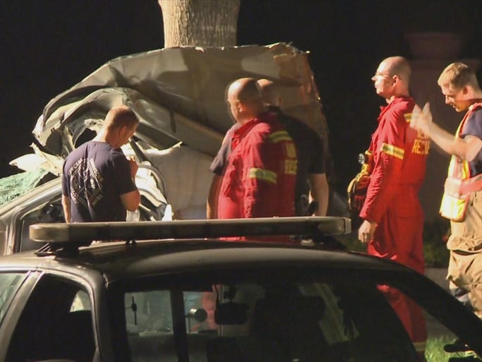 At least one person was killed when a driver wrapped a silver Magnum around a tree near Spring.