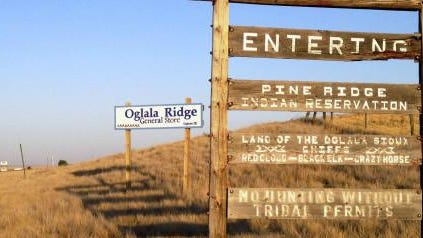2012 file photo of the entrance to the Pine Ridge Indian Reservation in South Dakota