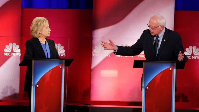 Democratic presidential candidate, Sen. Bernie Sanders, I-Vt.,  gestures towards Democratic presidential candidate, Hillary Clinton during the NBC, YouTube Democratic presidential debate earlier this month in South Carolina.