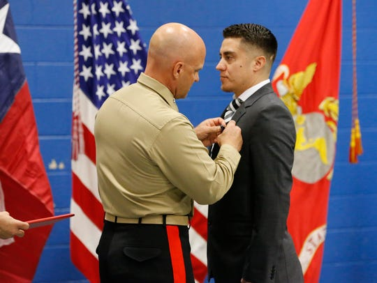Marine Lance Cpl. Benjamin Gonzalez was presented the Navy Cross, the military's second-highest honor awarded for valor in combat, by Sgt. Major Thomas Eggerling and Maj. Gen. David G. Beelon on Tuesday. Gonzalez was honored for his bravery in saving a fellow Marine during Operation Iraqi Freedom II in 2014.