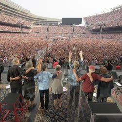 Bruce Hornsby, from left, Jeff Chimenti, Mickey Hart, Bob Weir, Phil Lesh, Bill Kreutzmann, Trey Anastasio of The Grateful Dead perform at Grateful Dead Fare Thee Well Show at Soldier Field on Sunday in Chicago.