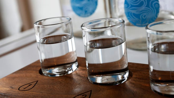Glasses of water are shown in the building where Colin Kloecker and wife Shanai Matteson are preparing to open a storefront Water Bar in Minneapolis.