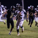 Church Point running back Frederick Williams (5) sprints away from Kaplan cornerback TJ Broussard to score a touchdown Sept. 18.