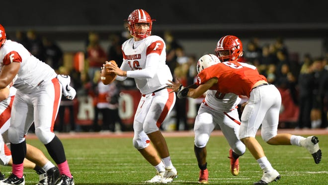 Aaron Carmack drops back to pass against Colerain.