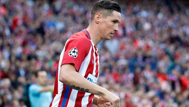 FILE - A Wednesday, May 10, 2017 file photo of Atletico's Fernando Torres during a Champions League semifinal between Atletico de Madrid and Real Madrid,.
