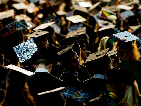 Graduates attend during the University of Tennessee College of Arts and Sciences Commencement Exercise at Thompson-Boling Arena in Knoxville, Tennessee on Saturday, May 13, 2017.