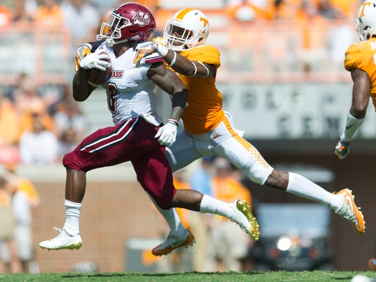 Tennessee defensive back Justin Martin (8) takes down