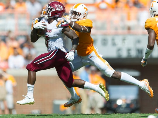 Tennessee defensive back Justin Martin (8) takes down UMass running back Marquis Young (8) during the Tennessee Volunteers vs. UMass Minutemen game at Neyland Stadium in Knoxville, Tennessee on Saturday, September 23, 2017.