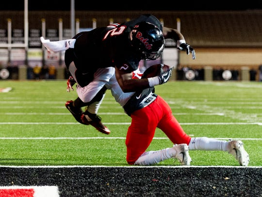 Maryville's Isaiah Cobb (2) leaps over Oakland's Malik Sibert (13) for a touchdown during the semifinal round TSSAA football playoffs between Maryville and Oakland high schools at Maryville High School in Maryville , Tennessee on Friday, November 24, 2017.