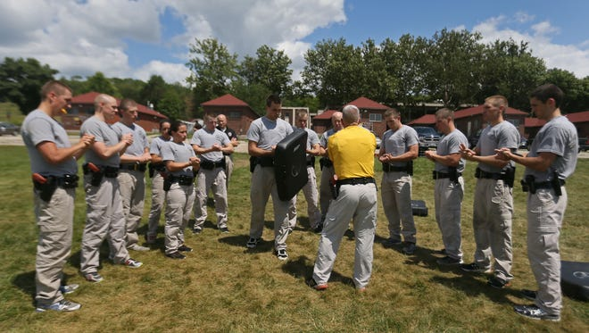 Peace Officer candidates train during the Iowa Department of Public Safety's 38th DPS Basic Academy at Camp Dodge Tuesday, July 29, 2014. Graduates of the 20 week academy will become Troopers in a ceremony November 7th.