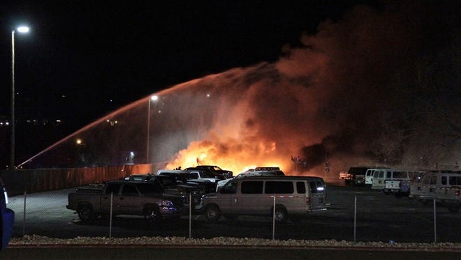 Flames rise from the wreckage of an American Medflight plane, Friday, Nov. 18, 2016, after it crashed in Elko. All four people aboard the air-ambulance flight were killed.