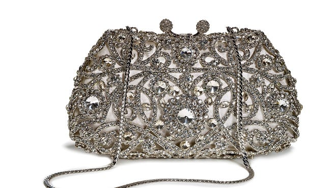 Embellished pieces spice up wardrobe basics. Crystal clutch, $149.99 at T.J. Maxx.