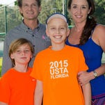 The Rhone family: Ethan and Erin (back) with Mason (left front) and Bennett (right front). Bennett, 12, has Ewing's Sarcoma, a rare form of bone cancer.