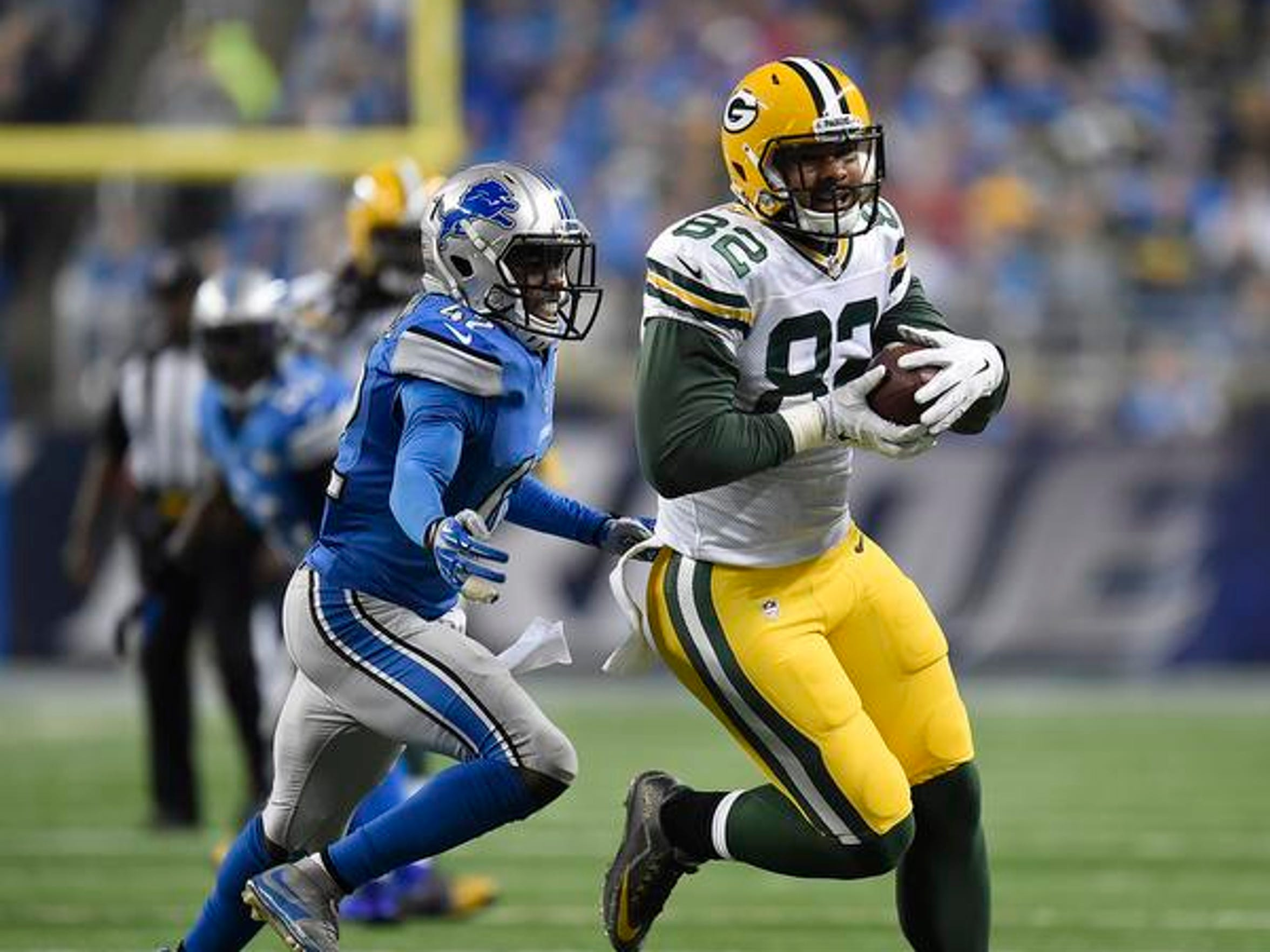 Green Bay Packers tight end Richard Rodgers runs with the ball after making a catch against the Detroit Lions at Ford Field.