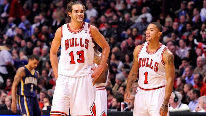 Chicago Bulls center Joakim Noah (13) and point guard Derrick Rose (1).