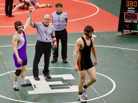 Sophomore Seth Henderson of MVCA has his hand raised after defeating Javon Merrill of West Lafayette 8-4 in the Division III state wrestling tournament March 9.