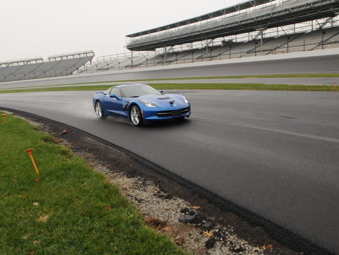 2013 Indy 500 winner, Tony Kanaan  along with Doug Boles President of IMS take a couple laps around the new road course at The Indianapolis Motor Speedway, Thursday, Nov. 21, 2013.