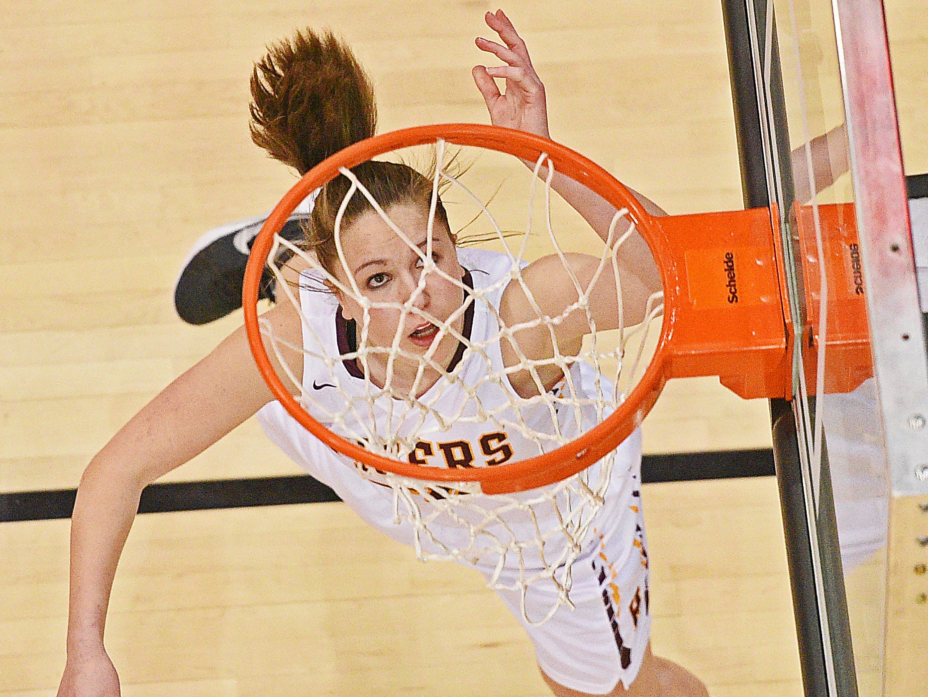 Harrisburg's Jeniah Ugofsky (30) goes up for a shot during a 2017 SDHSAA Class AA State Girls Basketball semifinal game against Rapid City Central Friday, March 17, 2017, at Rushmore Plaza Civic Center in Rapid City. Harrisburg beat Rapid City Central 49-44, and will play in Saturday's final.